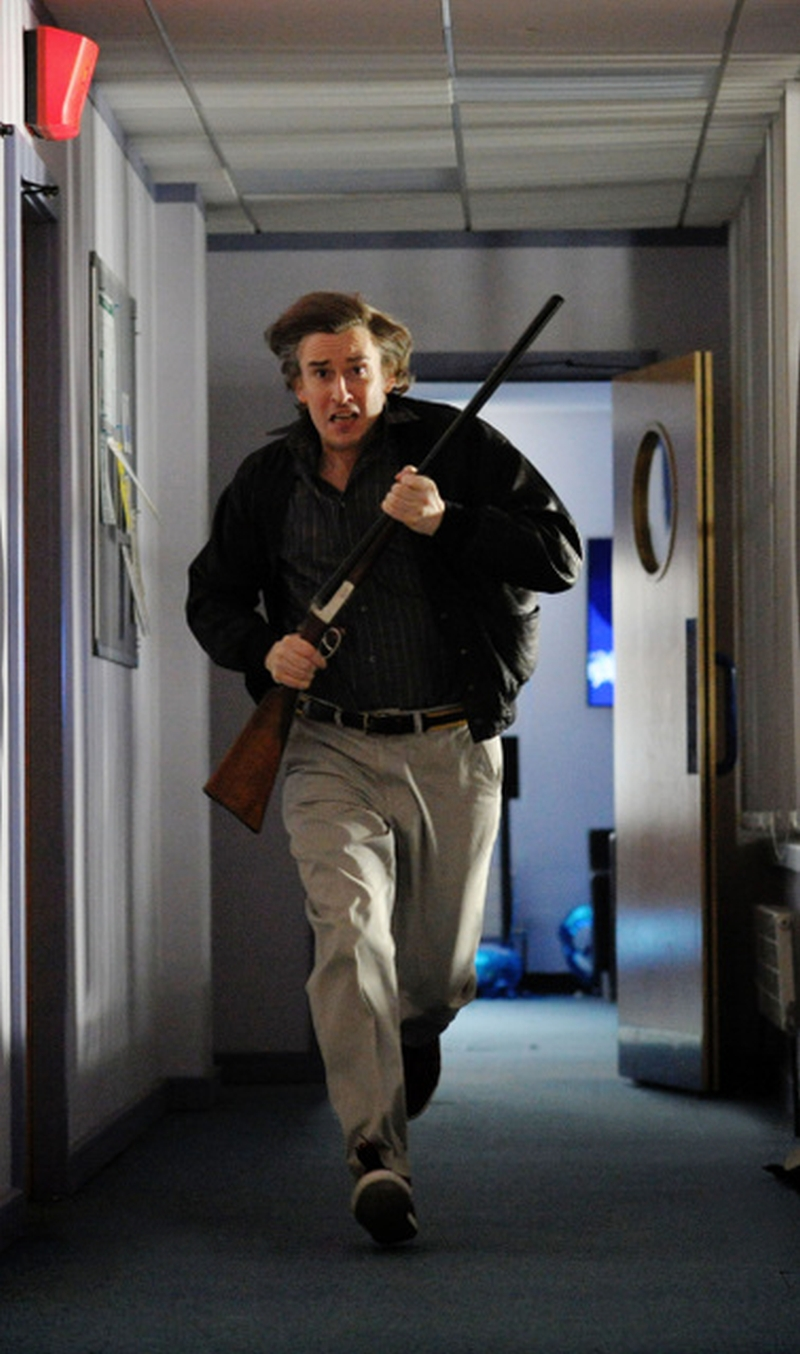 Steve Coogan in the Alan Partridge movie Alpha Papa gun corridor running