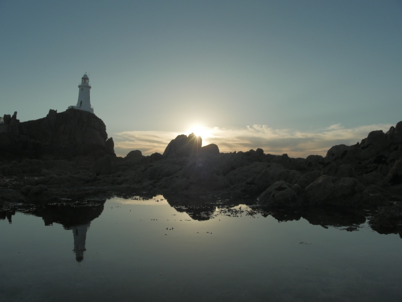 Dark Beacon lighthouse Jersey sunset